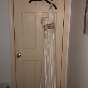 White one shoulder dress with gold jewel accents